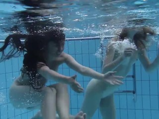 Hot lesbo action in the swimming pool