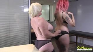 Hot lesbian lady doing striptease to seduce mature