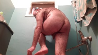Hairy guy is satisfied in the bathroom.