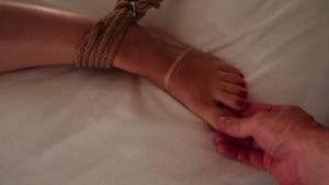 """Rope bound woman gets her beautiful feet tickled, and rubbed. Then her pussy gets massaged till """"O"""""""